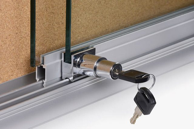 sliding door locks. one is fastened to the door and other frame it would be like a deadbolt for sliding glass lock locks